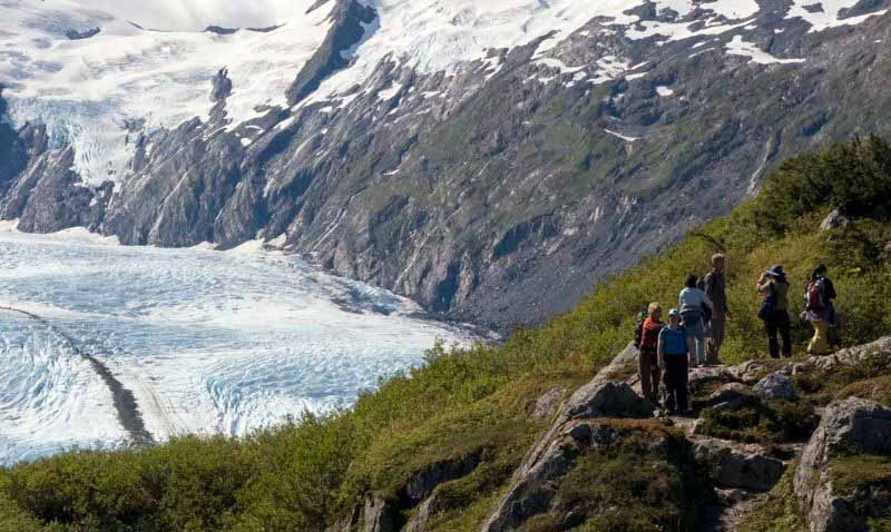 Hikers overlooking Portage Glacier, Alaska