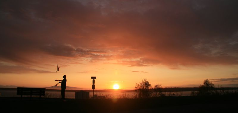 Juggler at the sunset, Sleeping lady in the background, Anchorage, Alaska