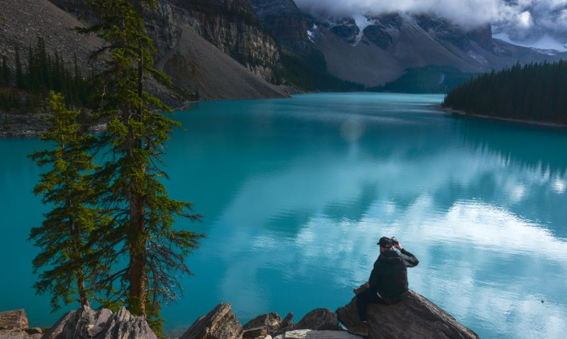 Photographer in Moraine Lake, Banff National Park, AB