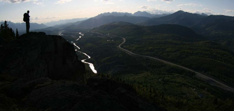 Hiker overlooking the Glenn Highway and Matanuska River, Alaska