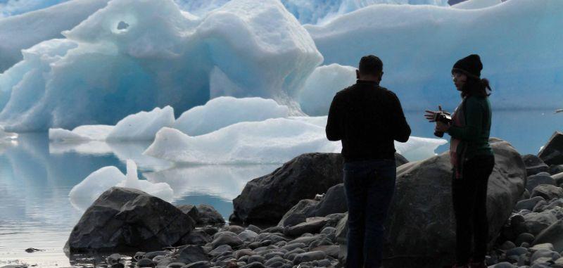 Hikers view icebergs in Lake George, Alaska