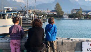 Family with kids observing the Valdez Harbor, Alaska