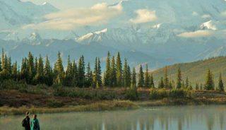 Hikers in Wonder Lake, Denali National Park, Alaska