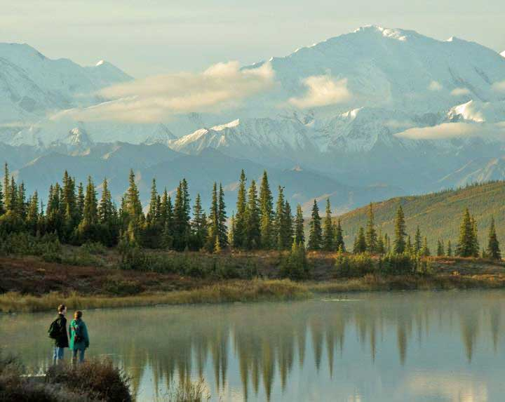 Hikers in Wonder Lake, Denali National Park, Alaska