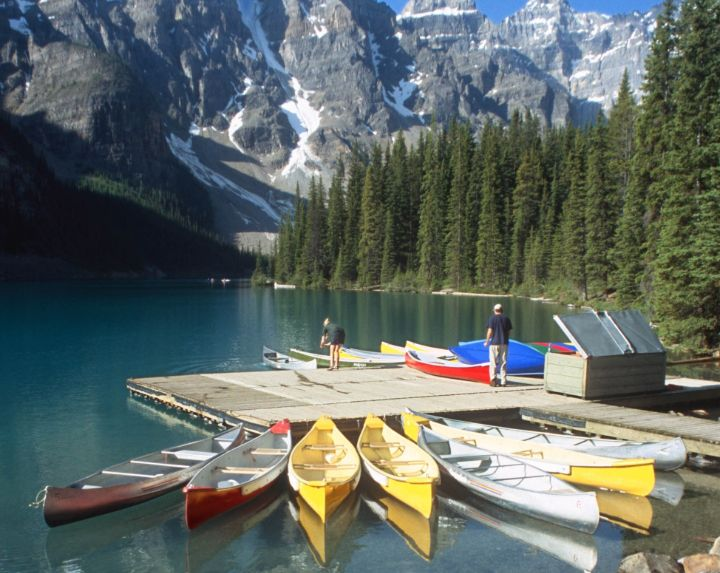 Canoes in Moraine Lake, Banff National Park, AB