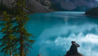 Photographer in Moraine Lake, Banff National Park, AB; image: Yuval Shapira